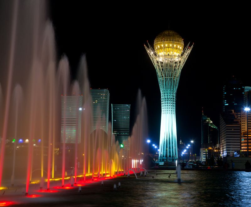 Bayterek observation Tower of Astana in the background with water feature in the foreground