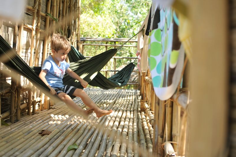 Child in hammock at longhouse