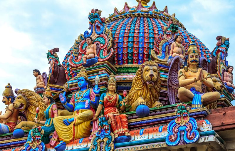 Ornate and colourful Hindu statues atop a temple at Little India