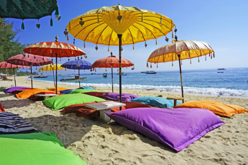 Colourful umbrellas and chairs on a beach in Bali