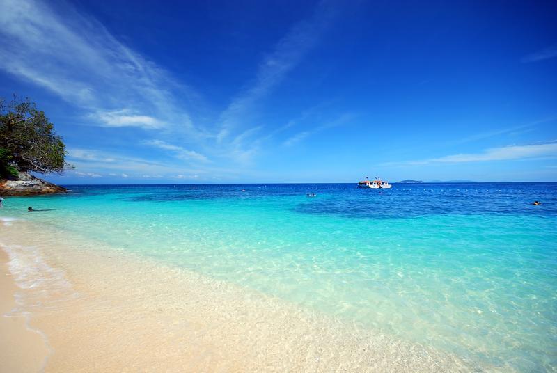 Clear seas, blue skies and clean beach of Perhentian