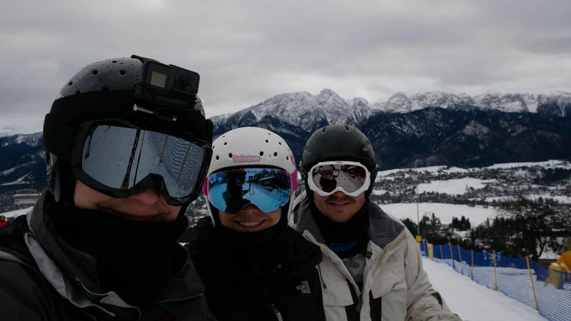 Lukasz with his sister and brother-in-law while Skiing in Poland
