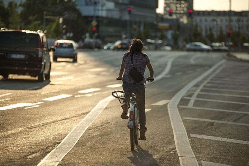woman riding bike, Berlin