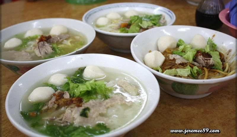 Several bowls of fish ball soup.