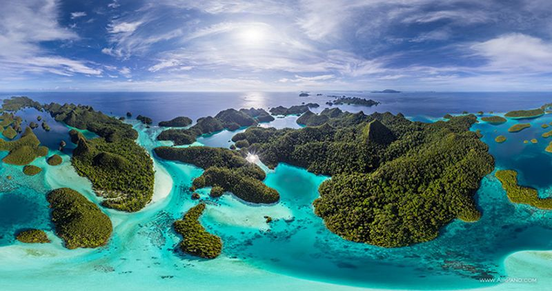 Wayag Island, Raja Ampat, Indonesia, aerial view, green wooded islands in the turquoise ocean