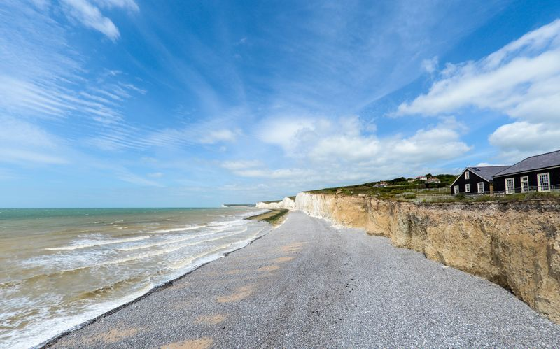 Birling Gap, East Sussex, white cliffs above a grey pebble beach