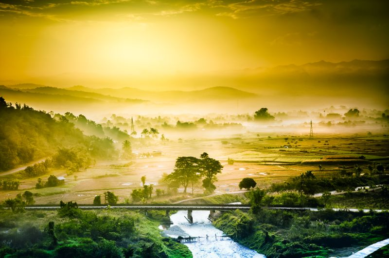 View of Kok River at sunset amidst greenery