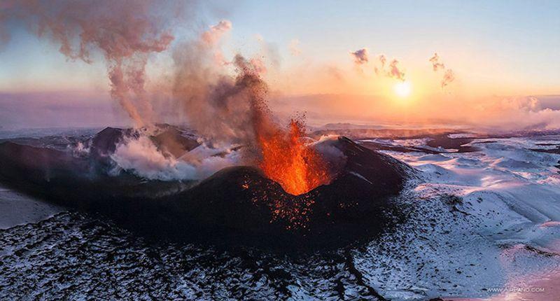 Erupting volcano, red lava, Russia