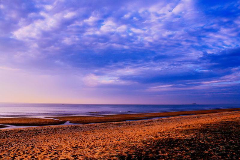 sandy beach with blue sky