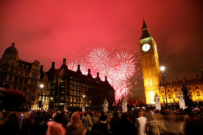 People watching fireworks at night in London