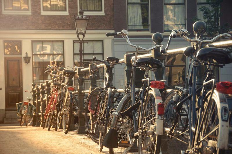 Bicycles against a bridge guardrail in Amsterdam, Netherlands