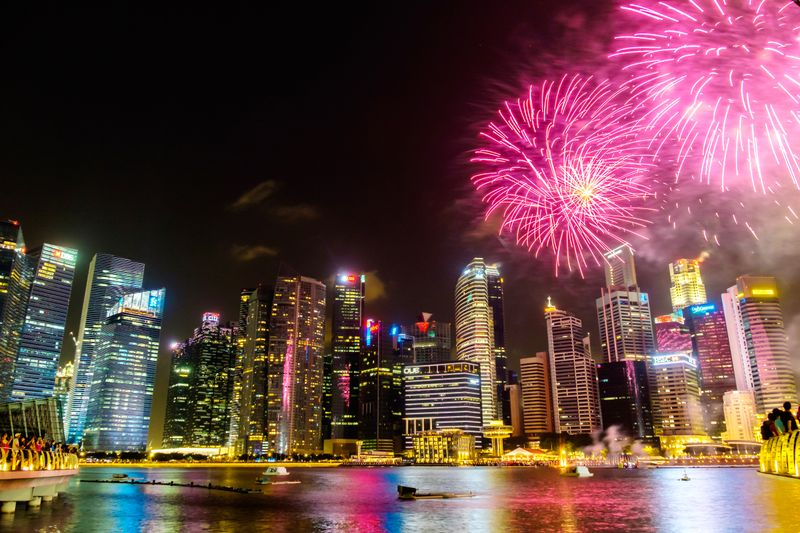 Fireworks by Singapore's skyline at night