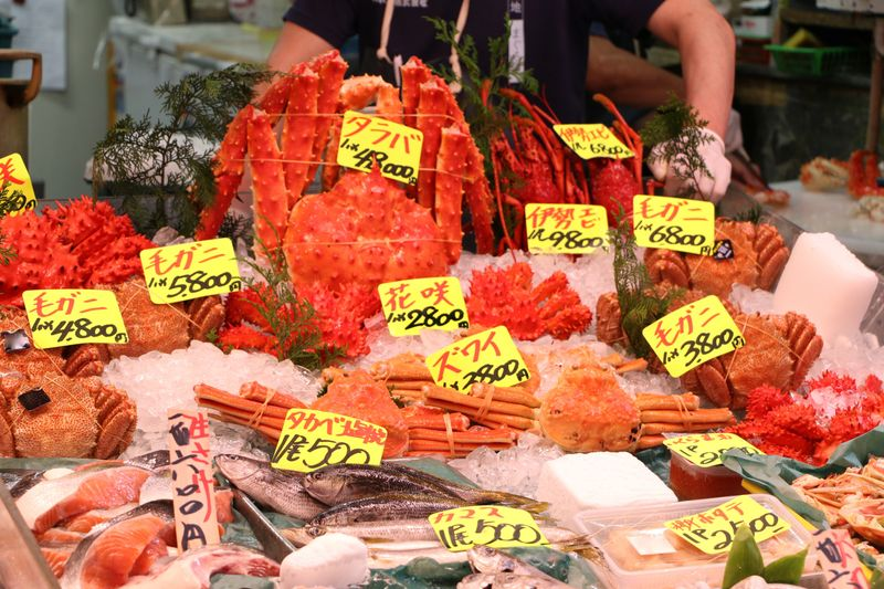 Close-up of the seafood at Tokyo's fish market featuring shellfish and fish