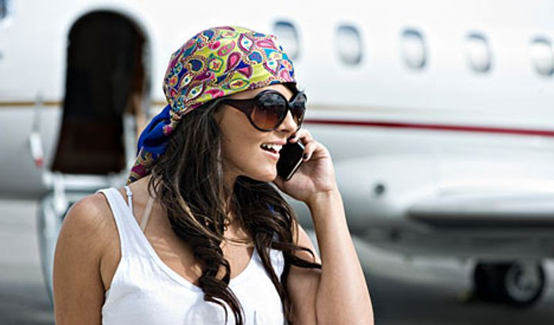 woman on phone by plane