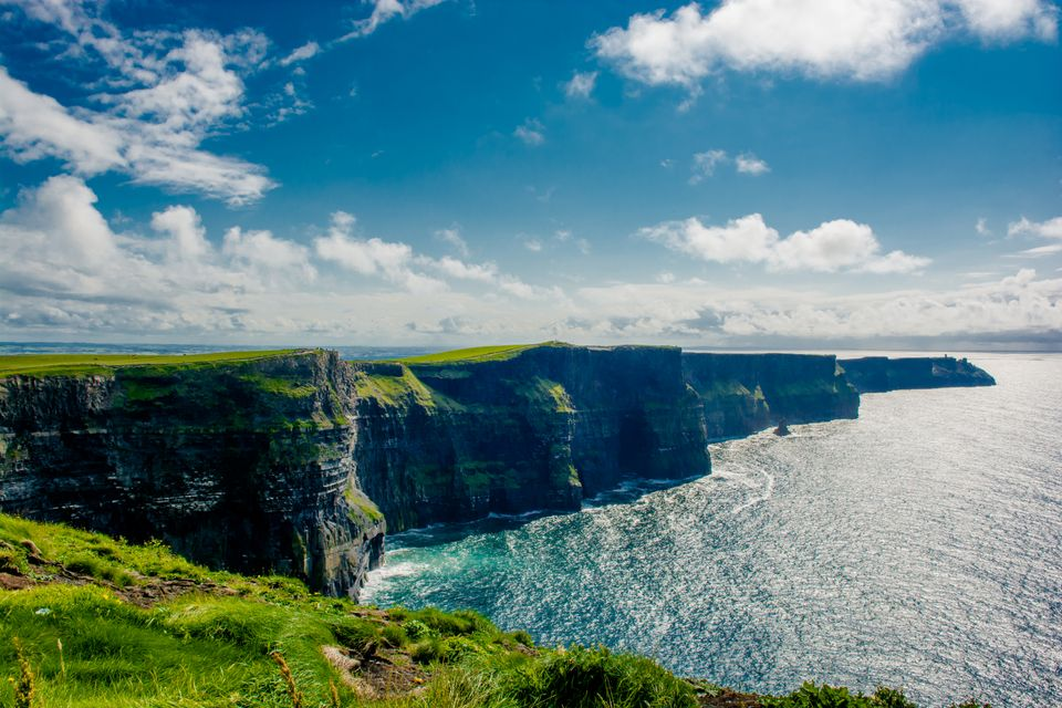 The spectacular Cliffs of Moher under a cloudy sky in Ireland