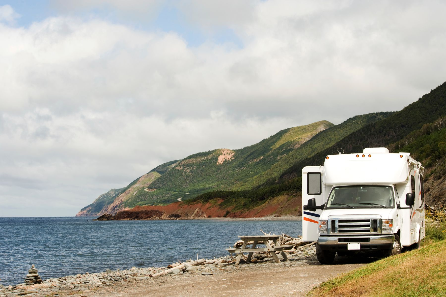 camper van parked at a rest stop along the shores of Cape Breton Highlands National Park, an underrated national park of Canada