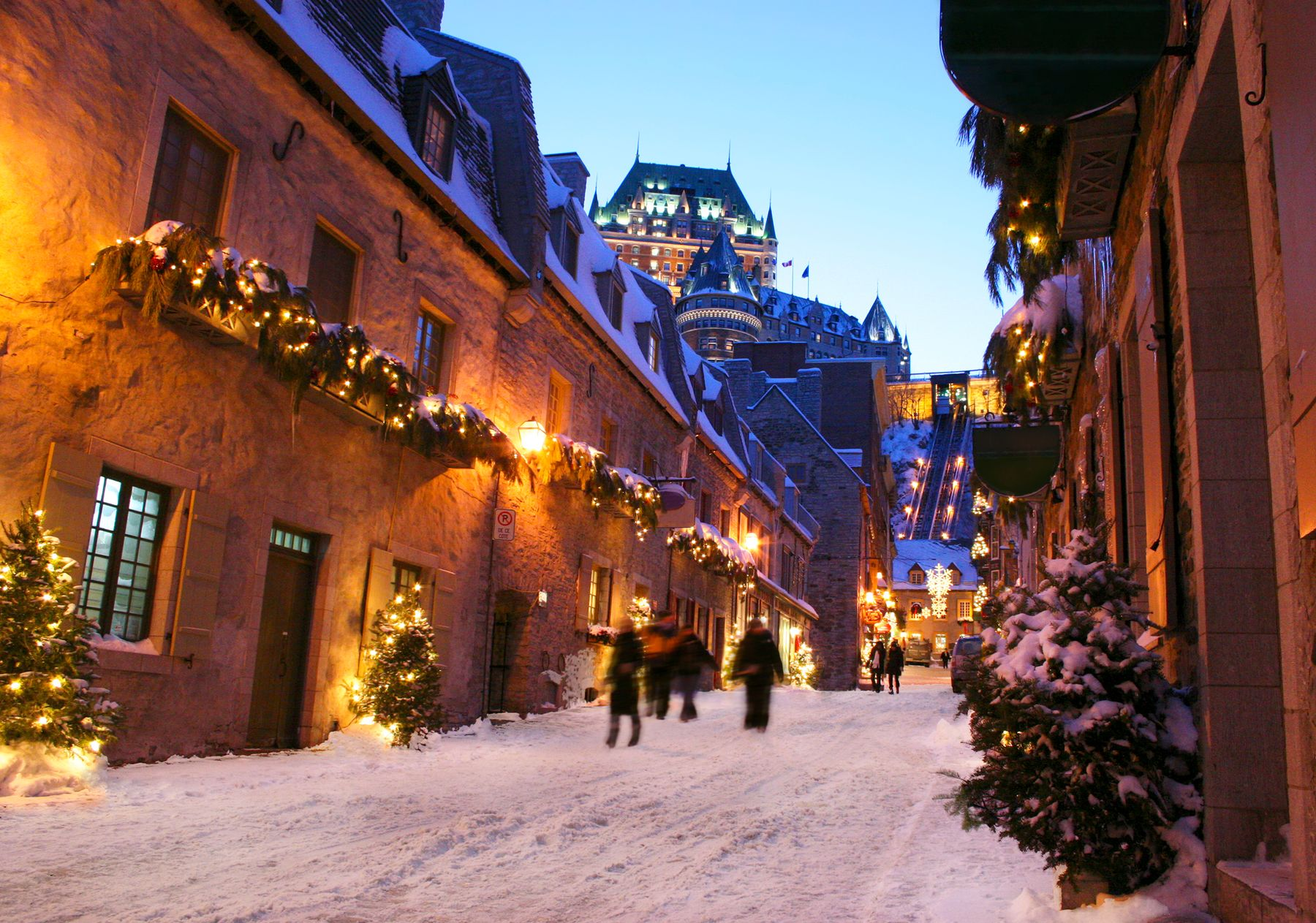 snowy streets before sunset in Old Quebec with the Chateau Frontenac in the background