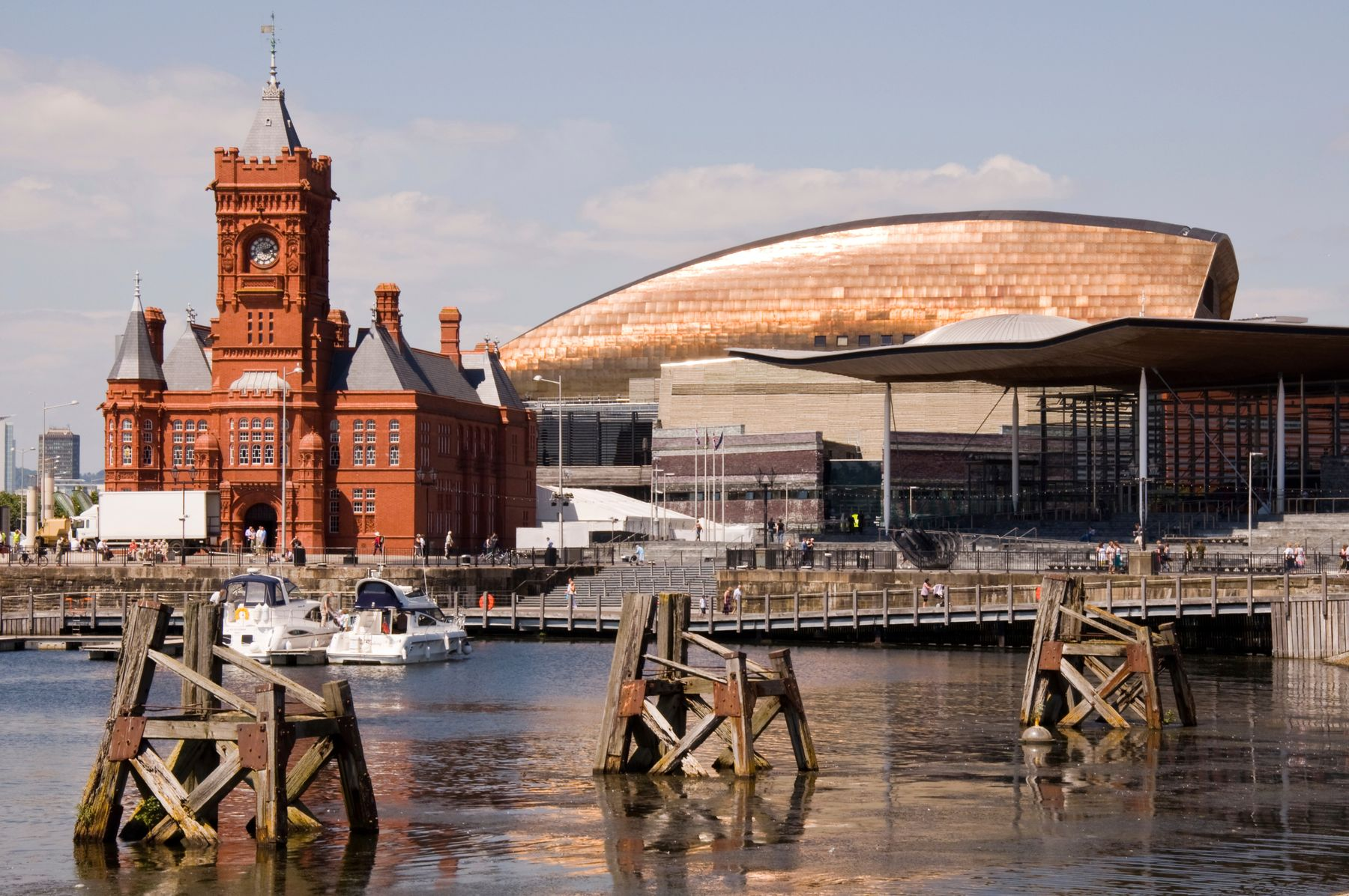 Picture shows Cardiff, one of the best places to visit in the UK, with the Pierhead building, the docks and the Wales Millennium Centre.