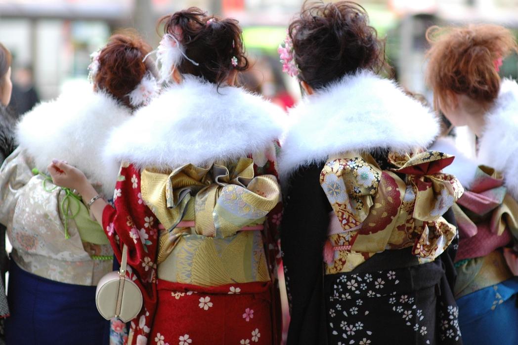 Women dressed as geyshas