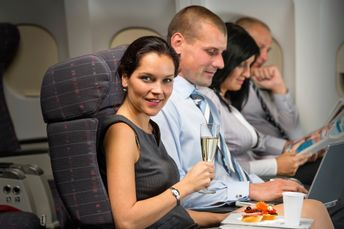 Woman in business class drinking