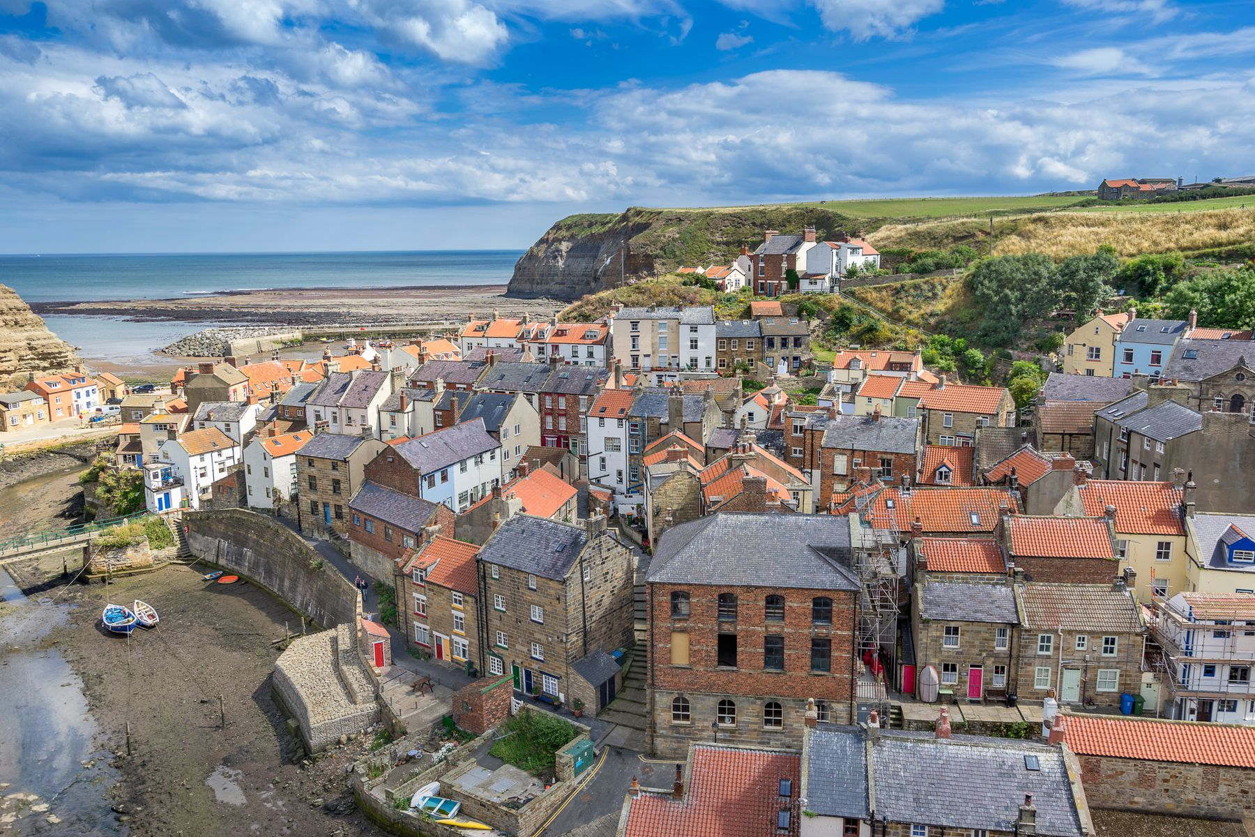 Aerial view of Staithes ith its small sandy fishing beach , one of the best places to visit in Yorkshire