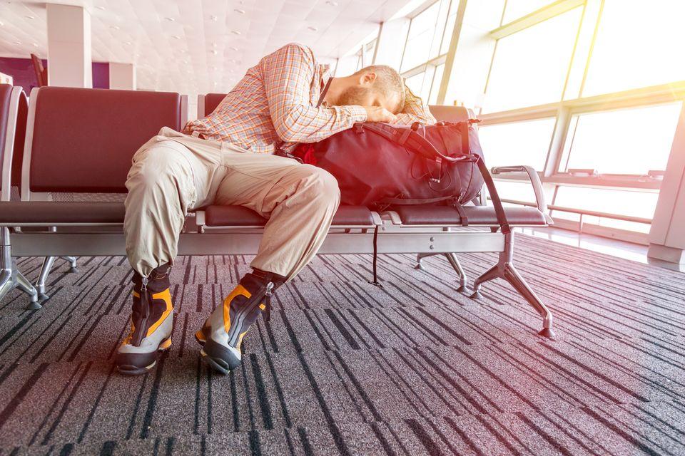 Man sleeping at the airport
