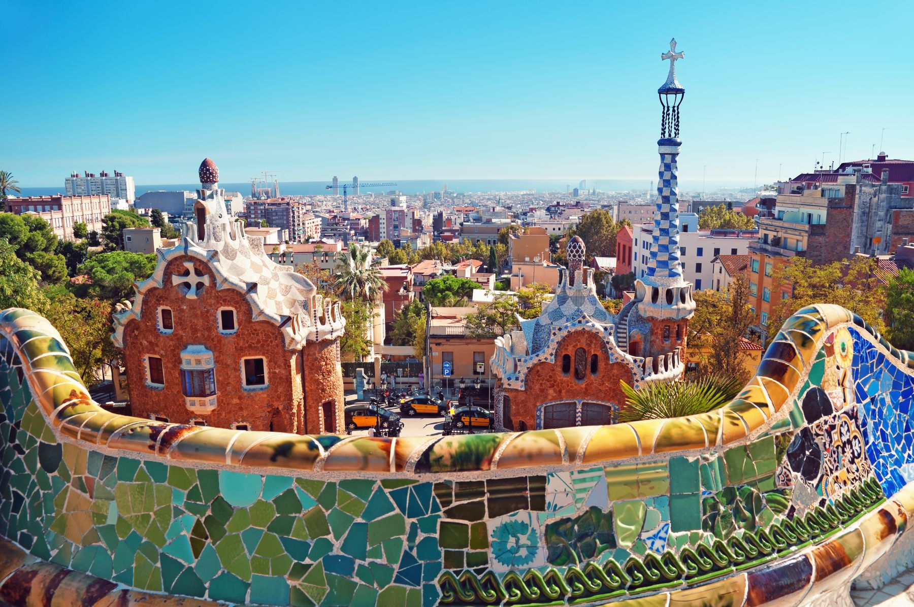 View overlooking Barcelona from Park Güell with beautiful blue and green mosaic pattern