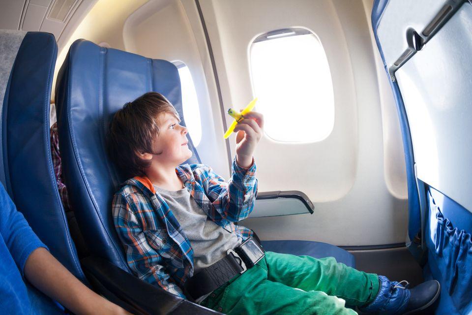 Little boy on a plane