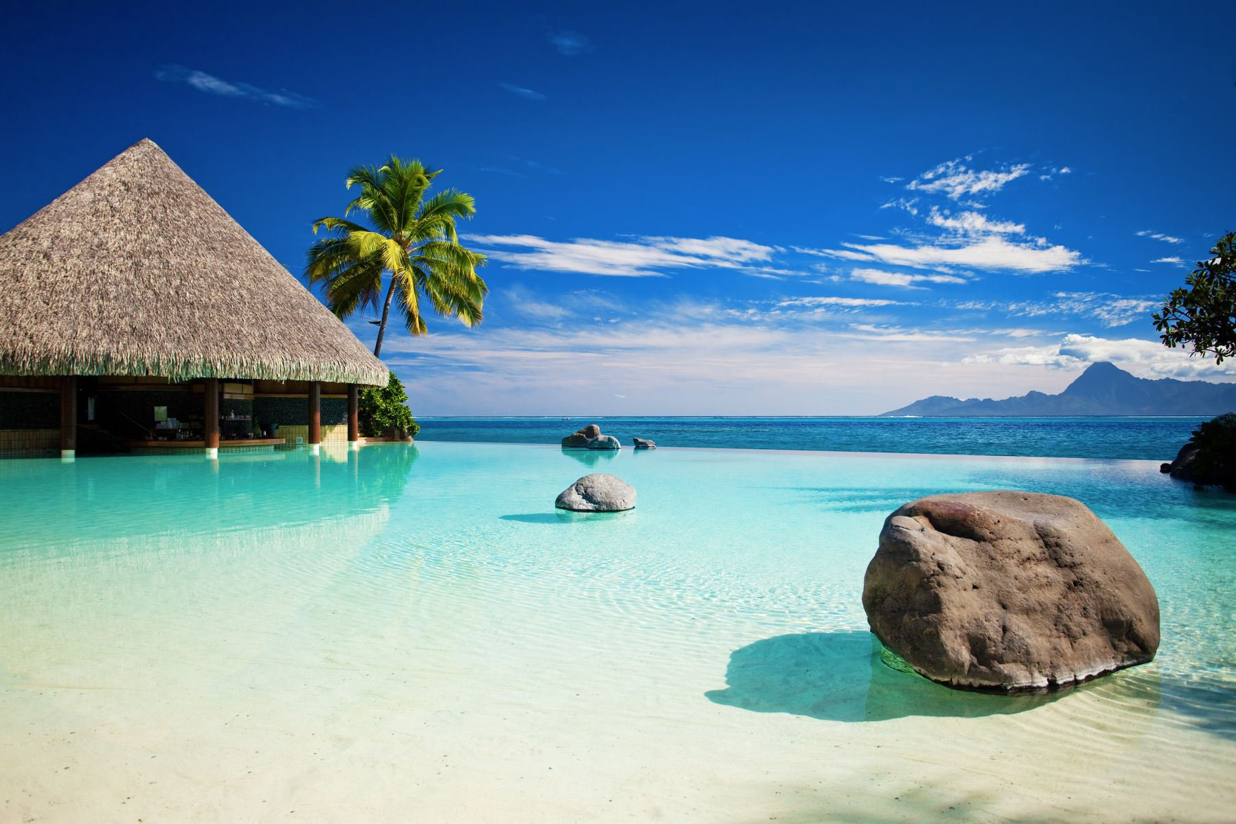 Overwater bungalow and turquoise seas in Tahiti, French Polynesia