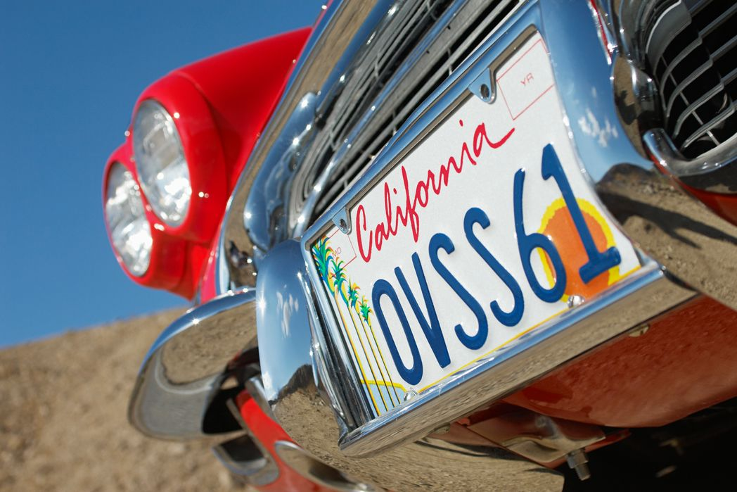 California license plate on a red car