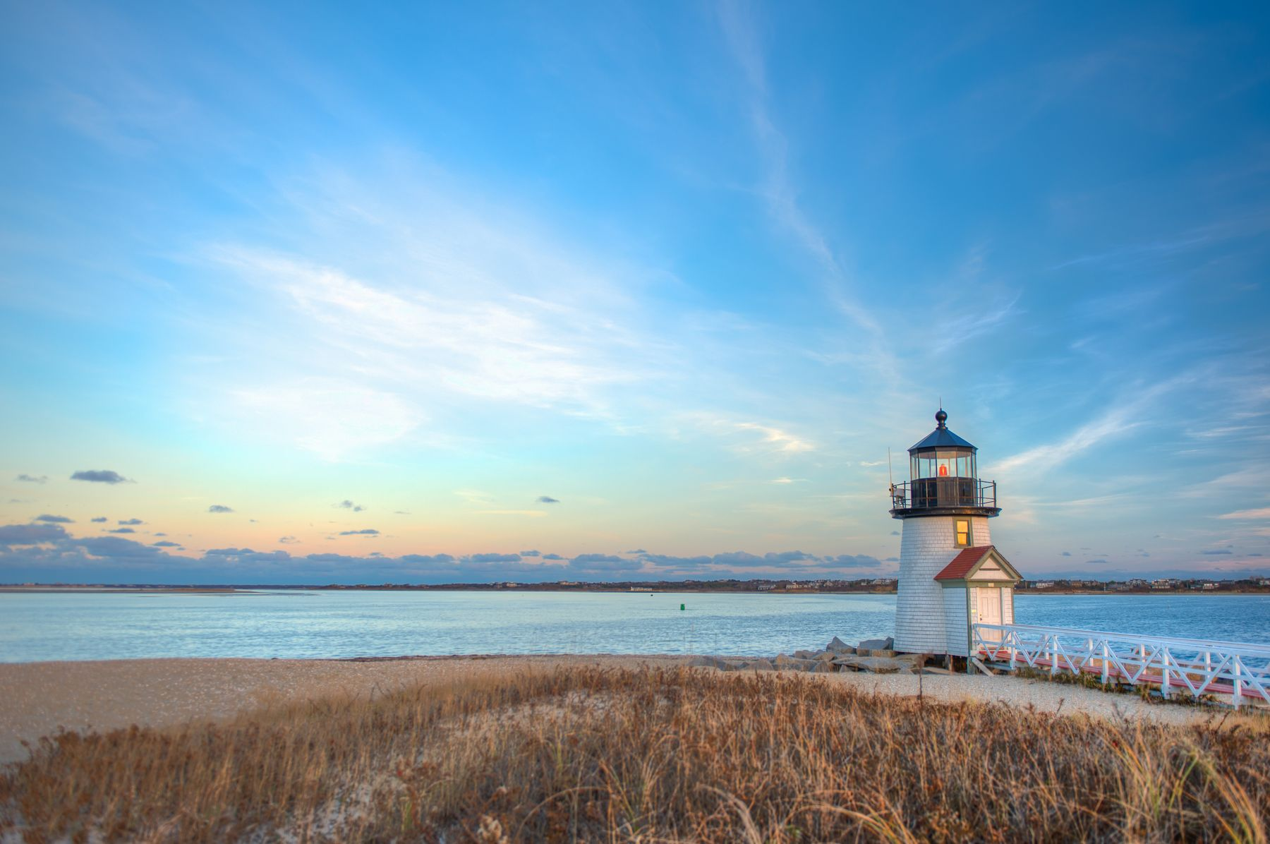 Lone lighthouse standing on the beach on Cape Cod