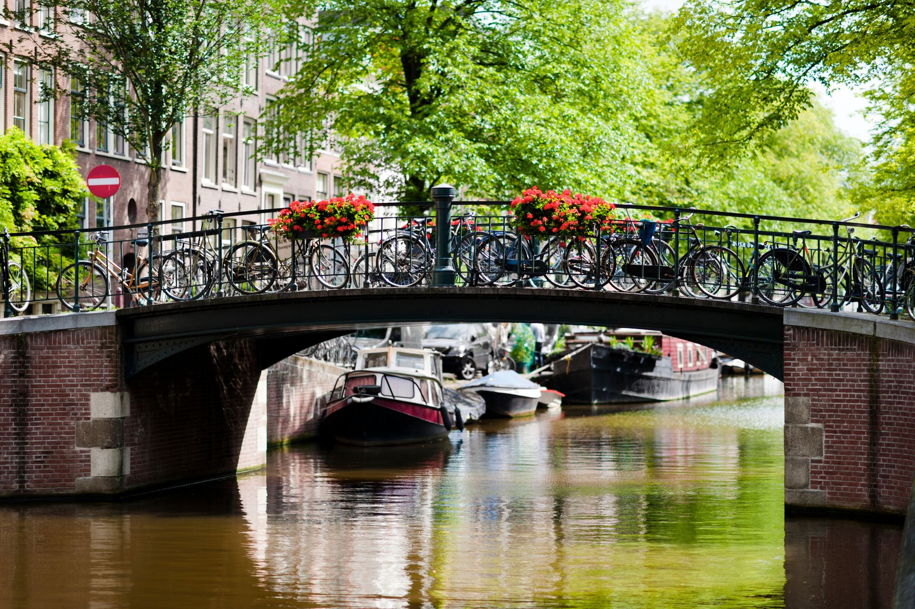 canal and bridge with bikes leaning against the bridge in Amsterdam