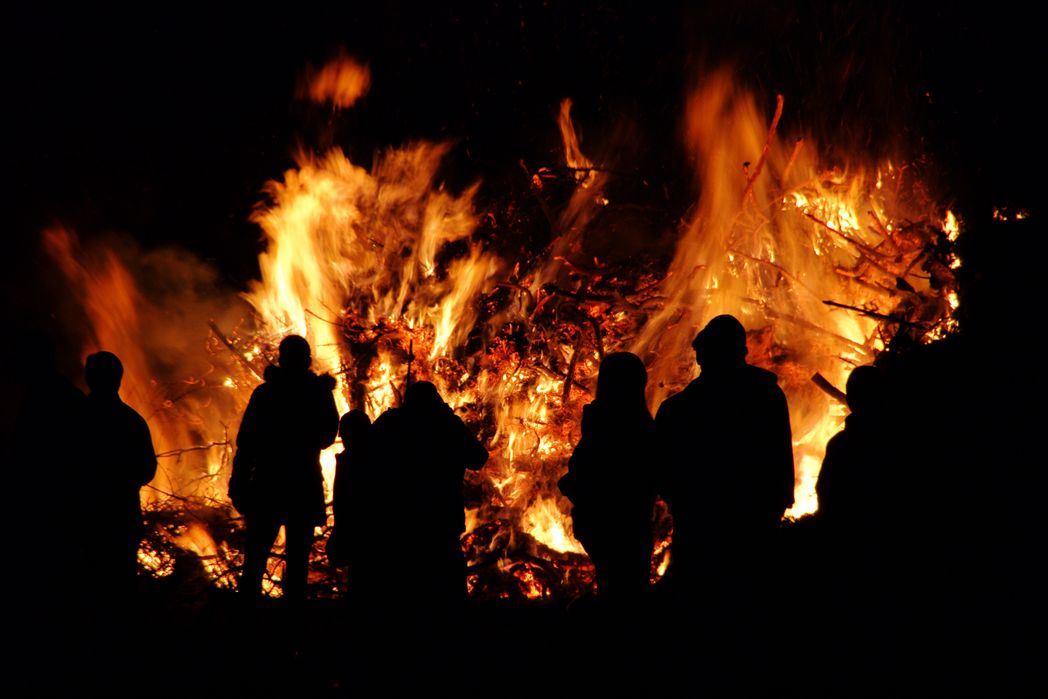 People around the fire at night - Uisneach Bealtaine Fire Celebration