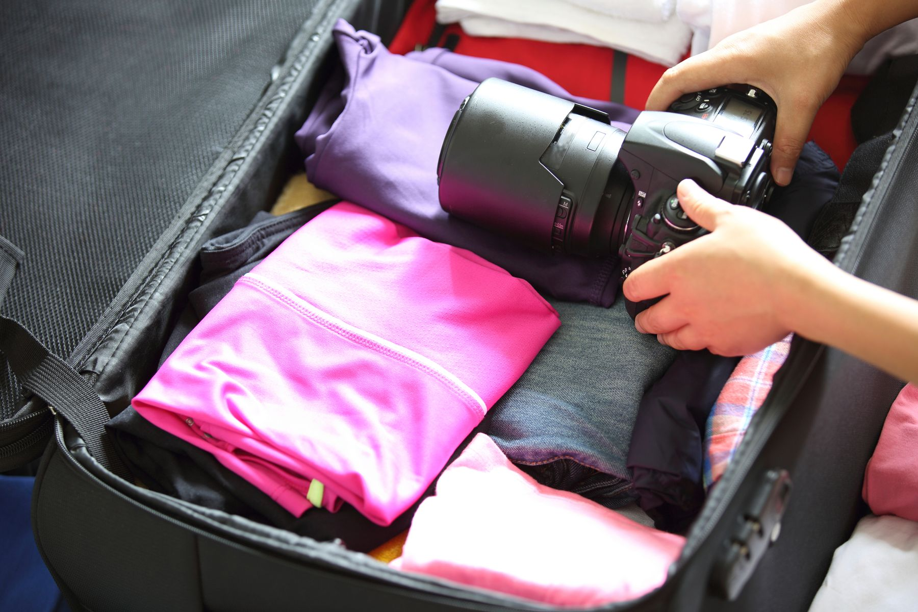 A camera being placed into a suitcase