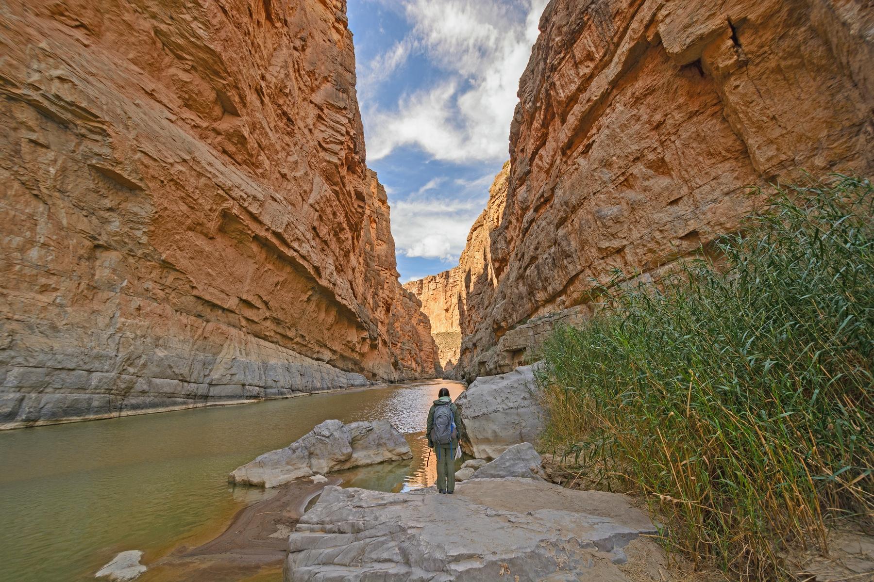 small man inside a river canyon