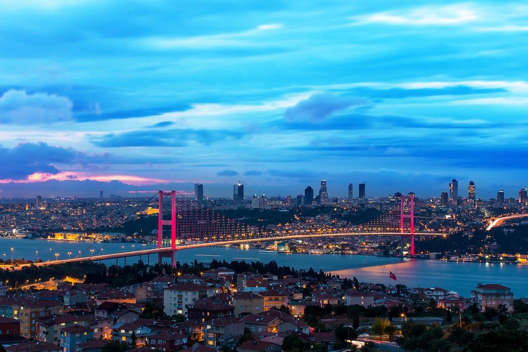 The Bosphorus Bridge in Istanbul illuminated at sunset