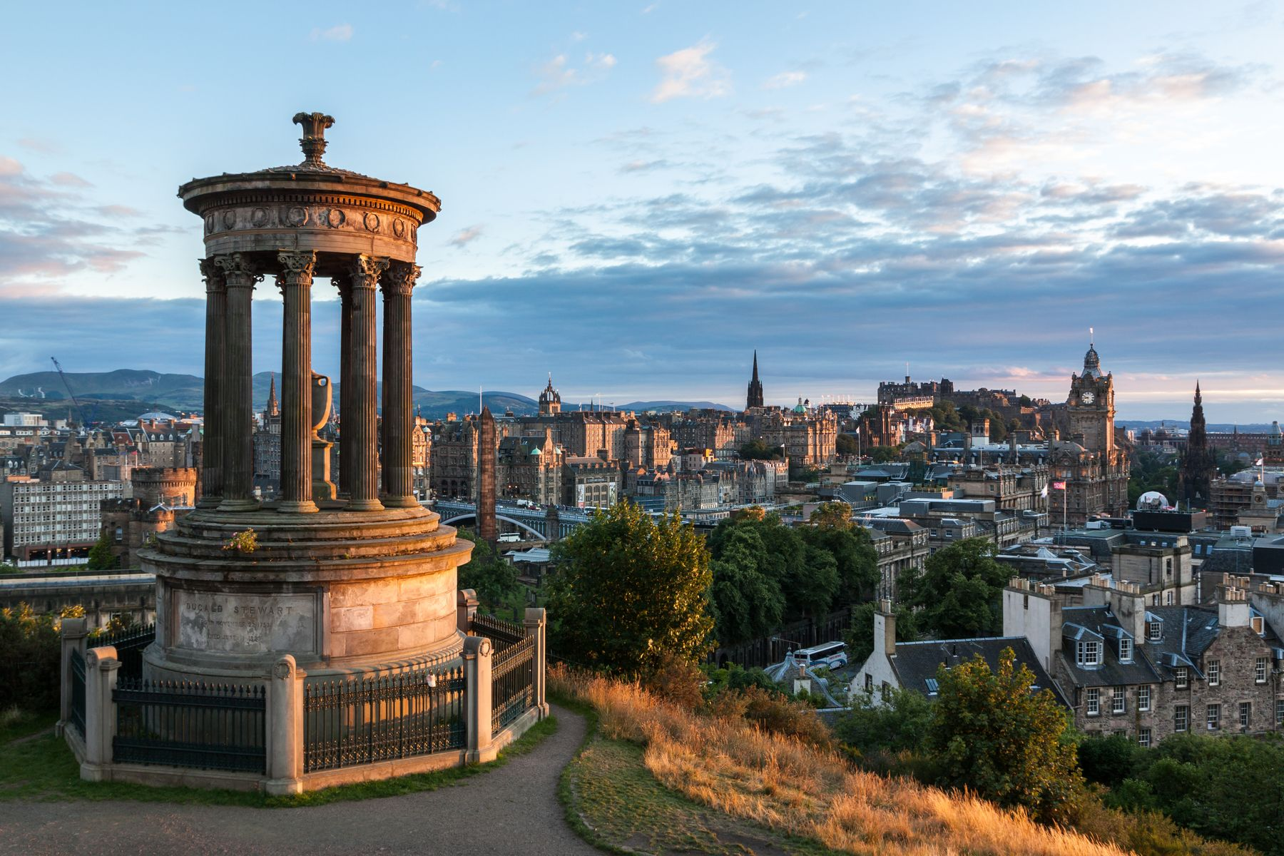 Picture shows the city of Edinburgh skyline, as seen from the top of Calton Hill with the National Monument of Scotland in the foreground.