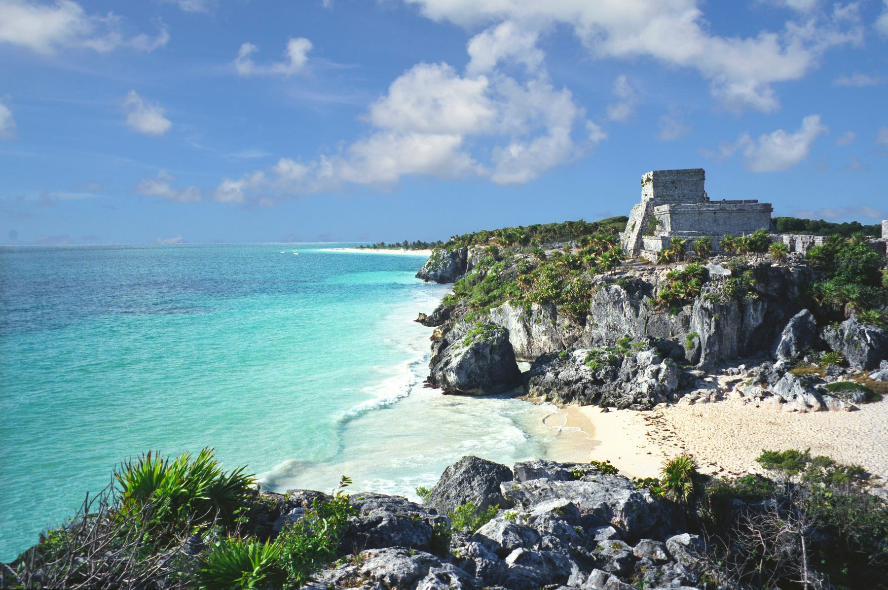 Mayan ruins overlooking the turquoise waters and a quiet beach in Tulum, Mexico