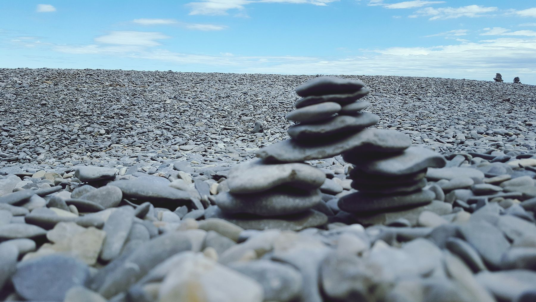rocks stacked up along the shore in Forillon National Park, a great spot for camping in Quebec