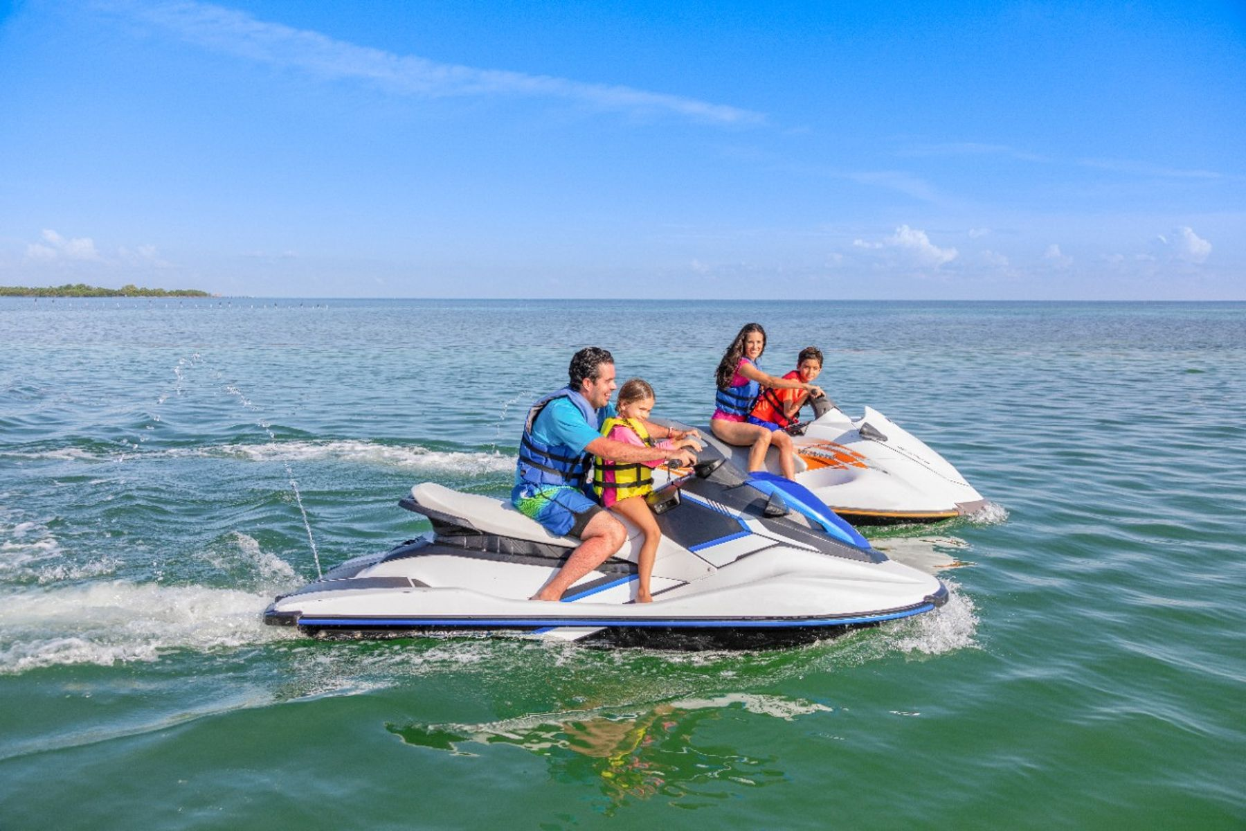 Family on Jetskis outdoor activities in Florida