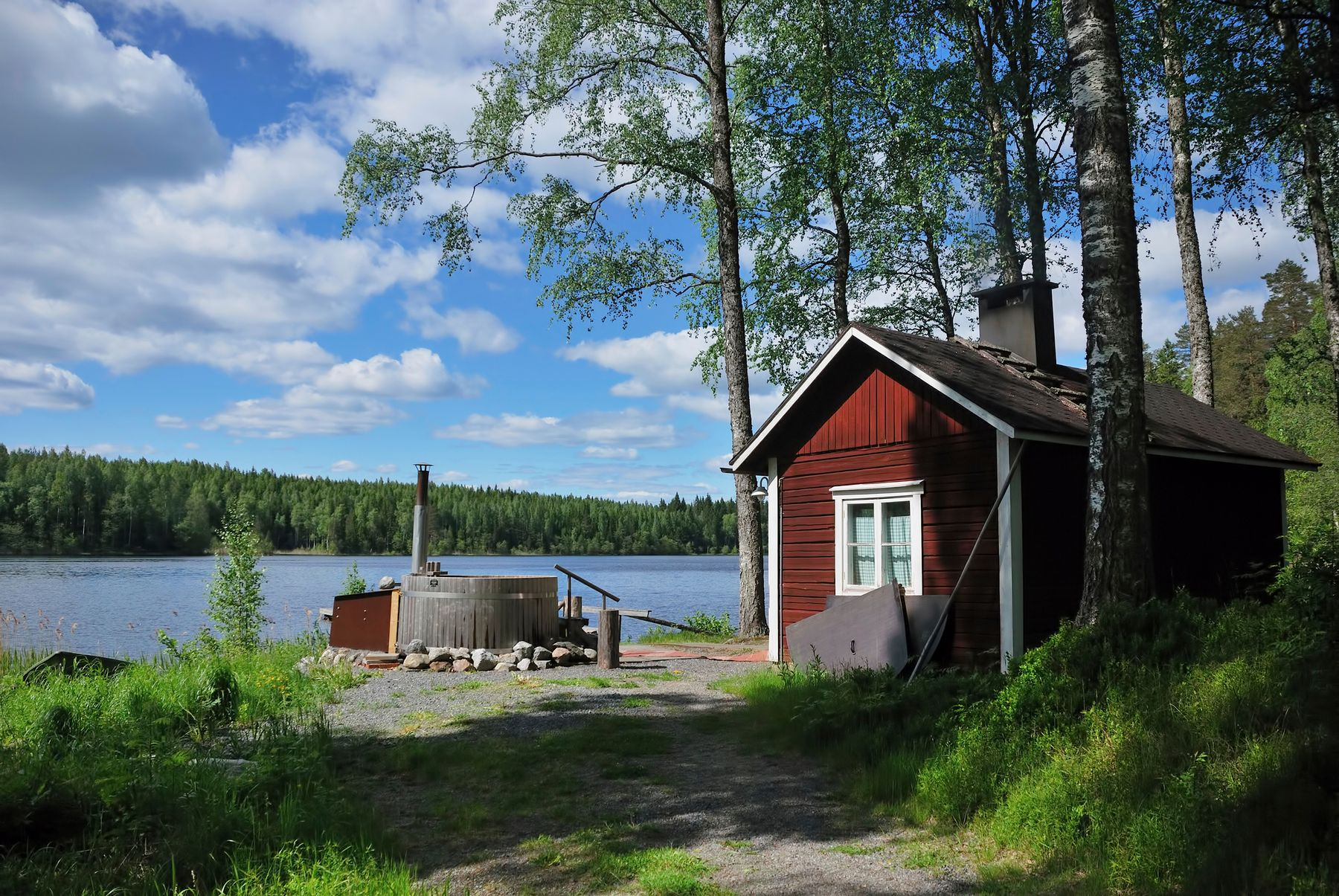 cabin by the lake in the woods