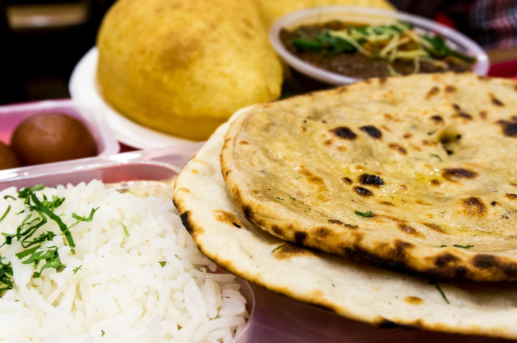 a plate of dahl with naan and rice in New Delhi