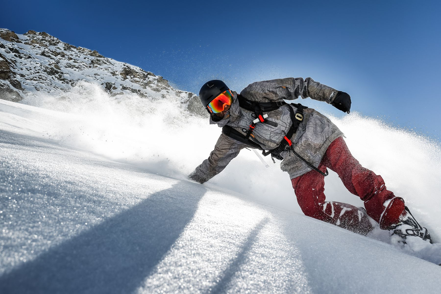 person skiing on a powdery mountain on a sunny day