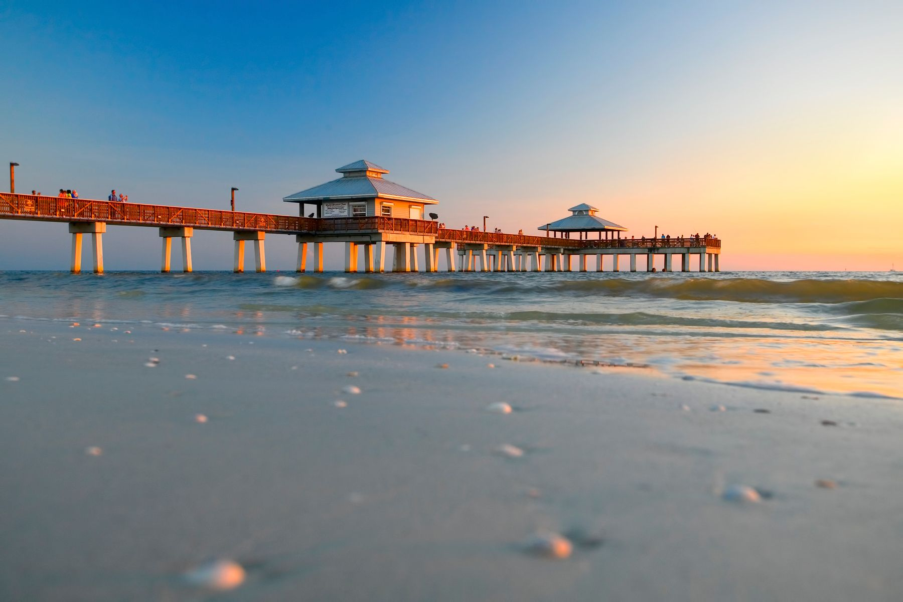 view of Fort Myers beach pier at sunset