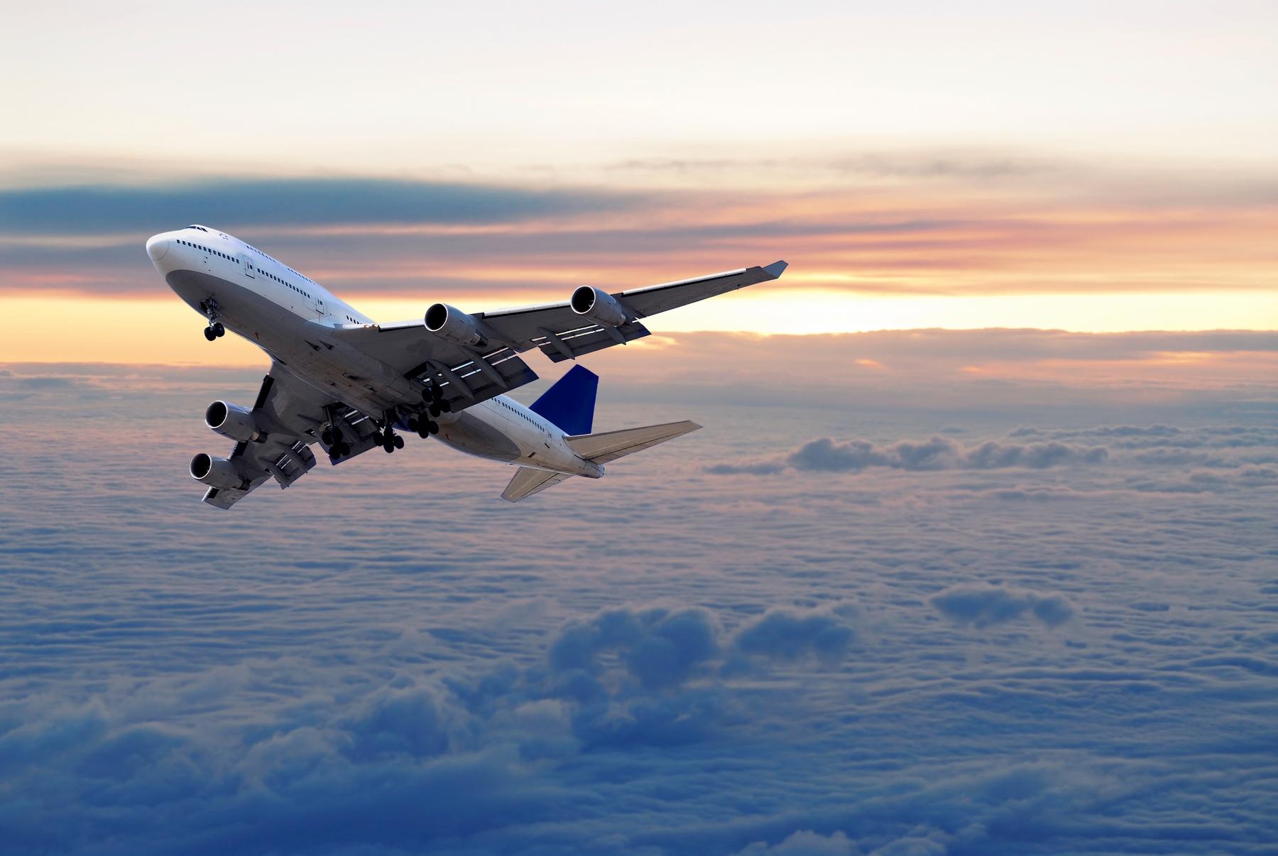 Aeroplan taking off at sunset