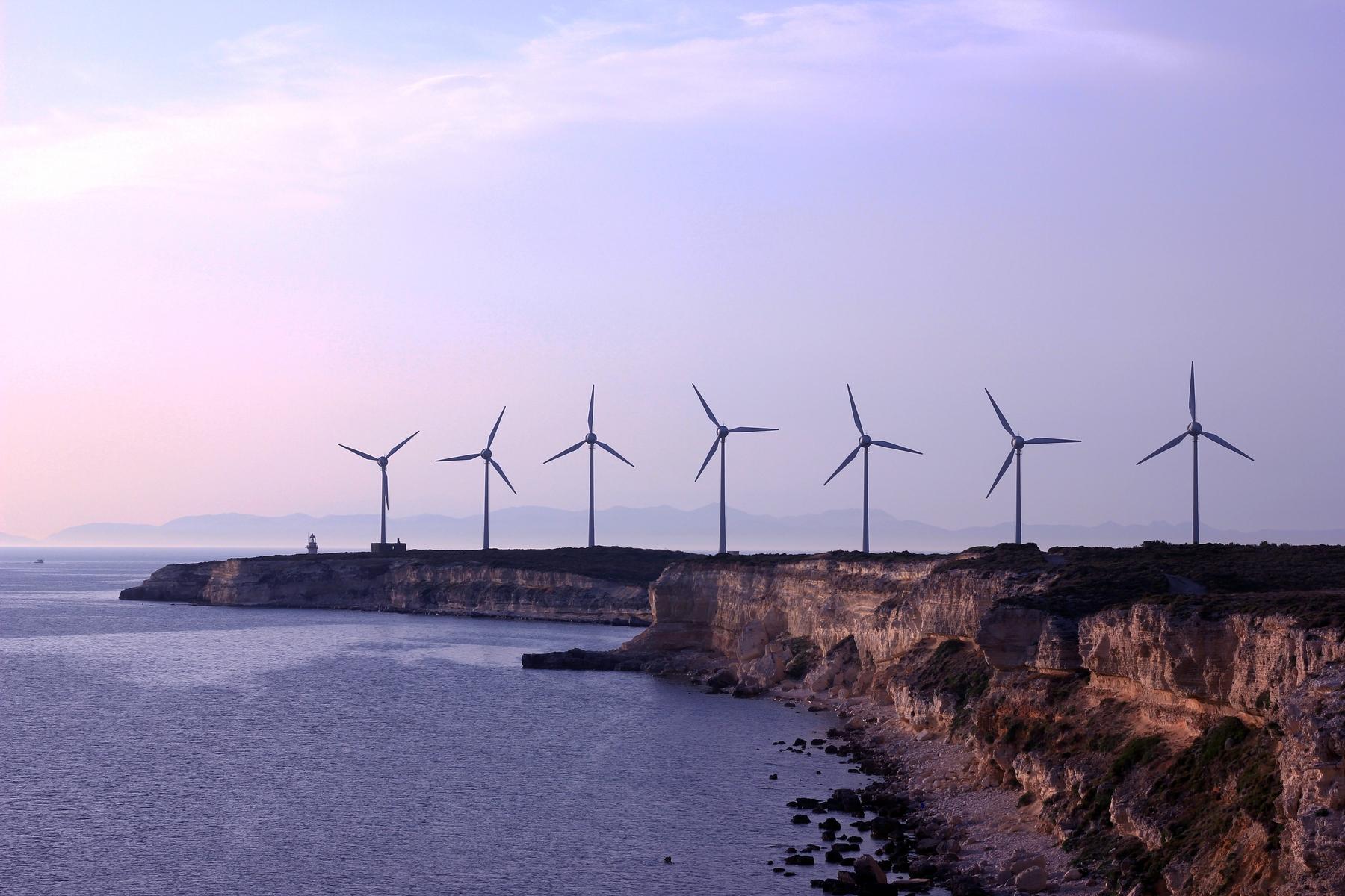 Sustainable destinations using renewable energy sources like wind turbines
