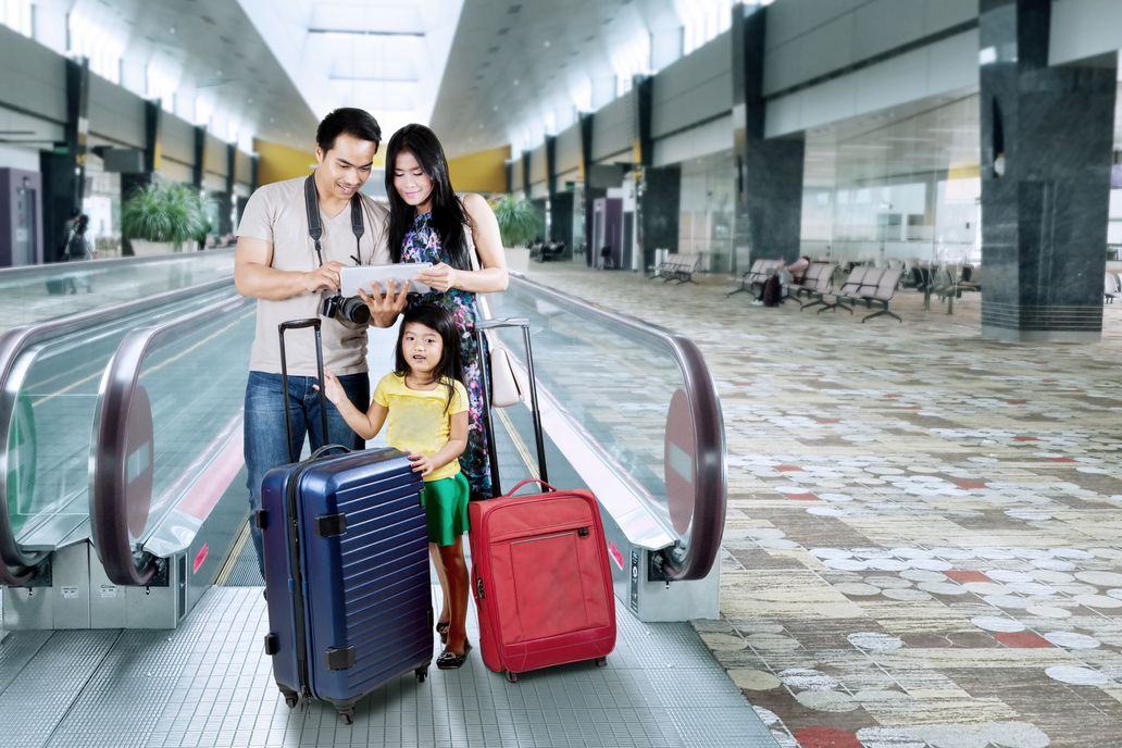 A family looking at a map at the airport