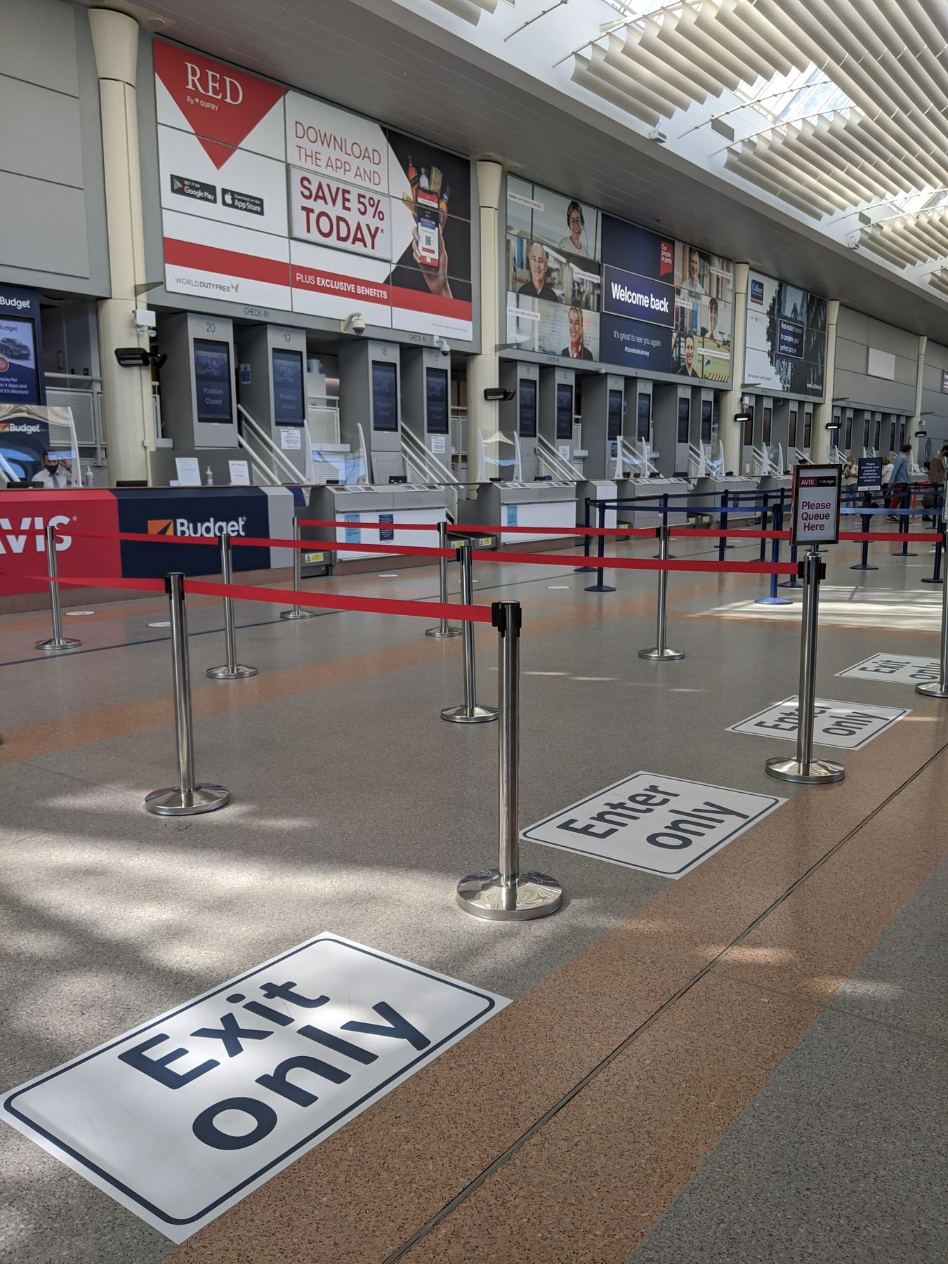 exit and enter lanes at the airport check-in counters