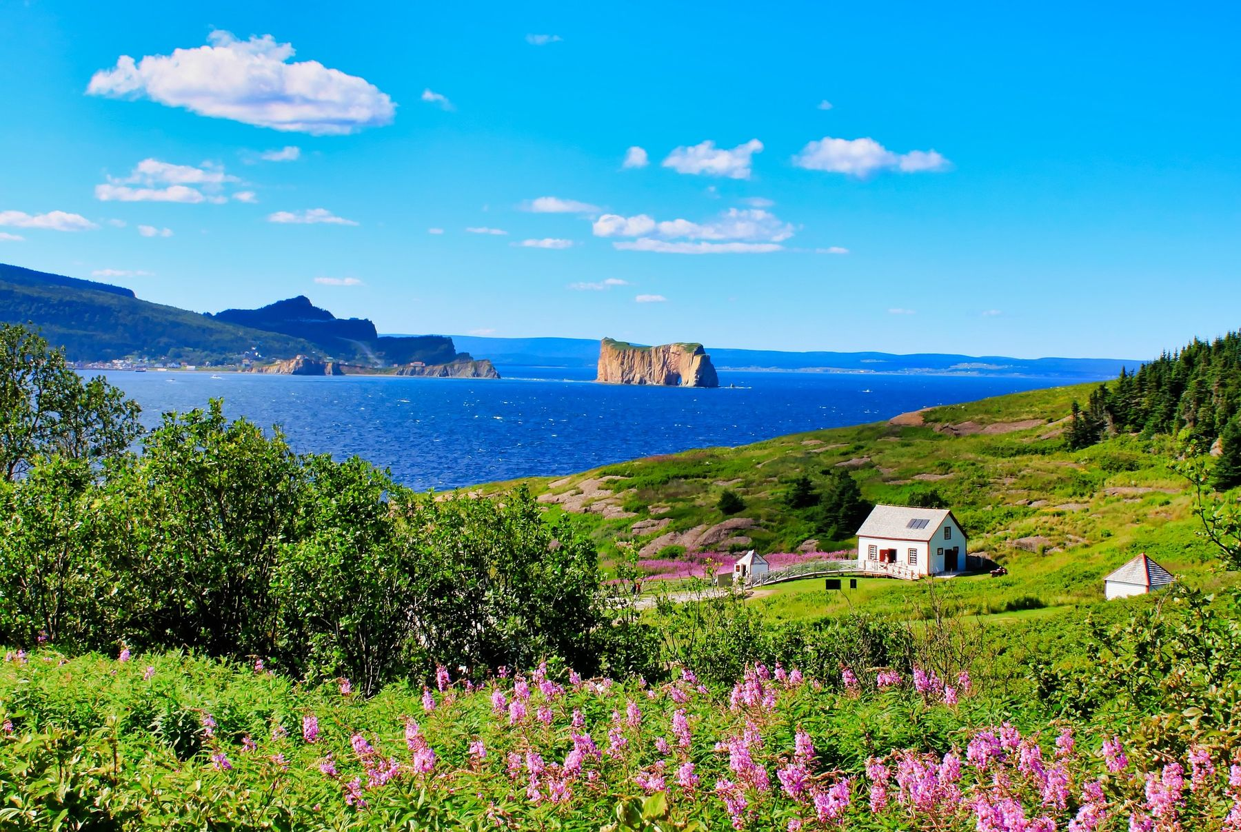 cliffside in the town of Gaspe on a sunny summer's day with the Rocher Perce in the distance