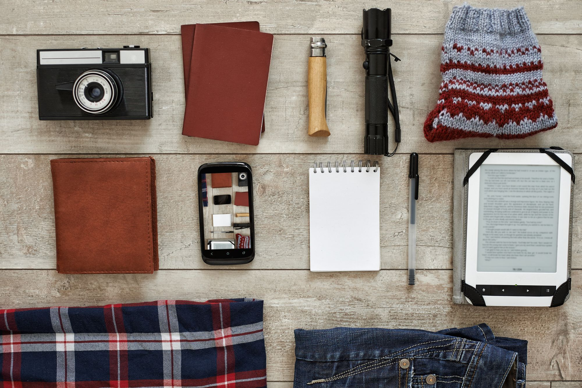 Camera, torch, phone, notebook and other travel essentials to take with you in your cabin bag